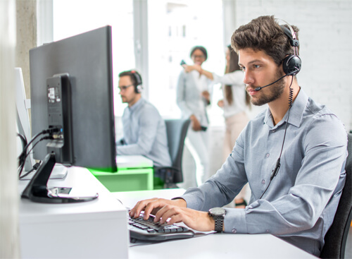 A call centre agent is looking at his monitor
