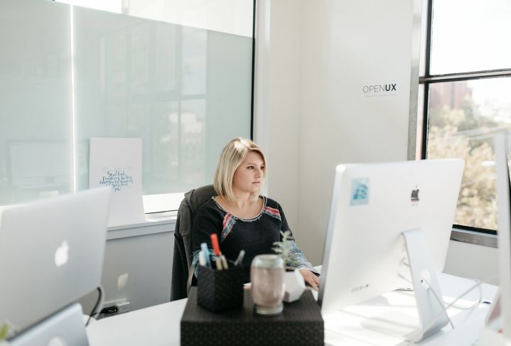 woman staring at computer alone