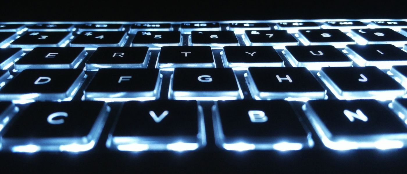 Closeup of backlit laptop keyboard