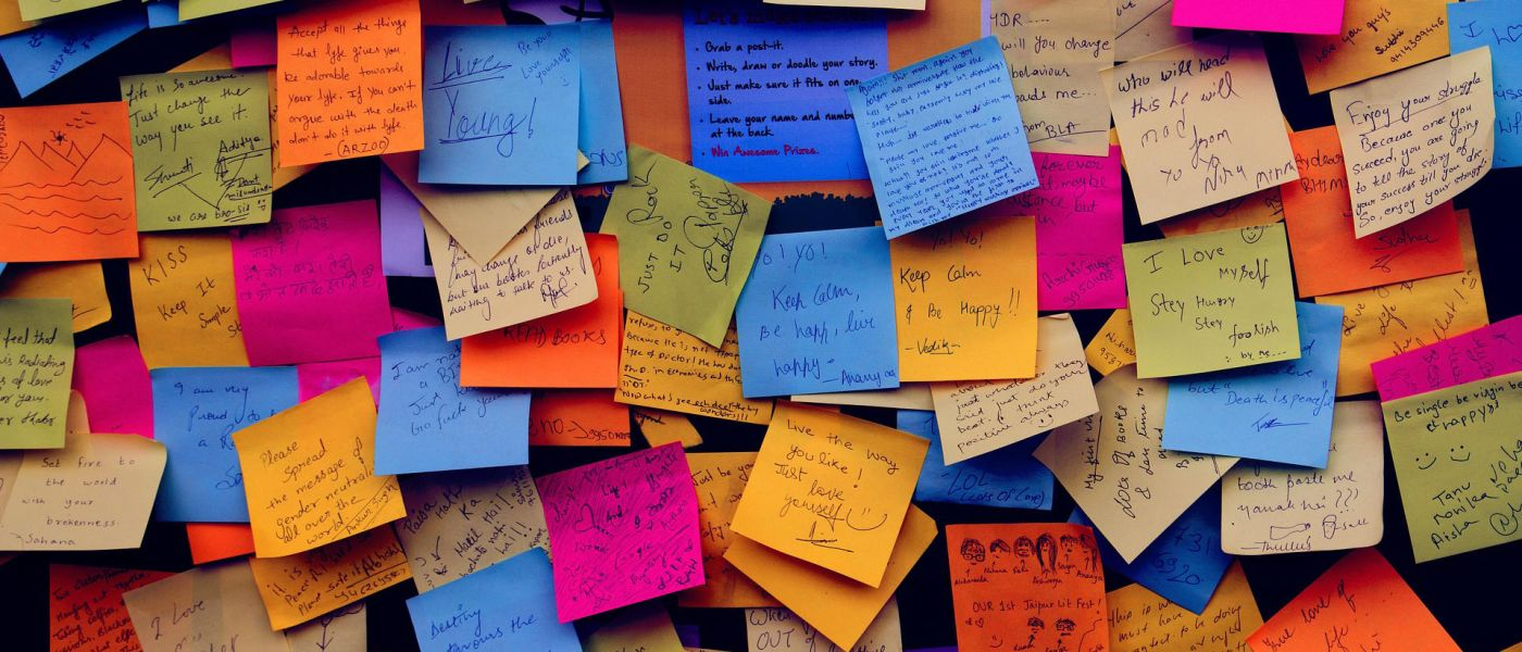 post-it notes covering a bulletin board