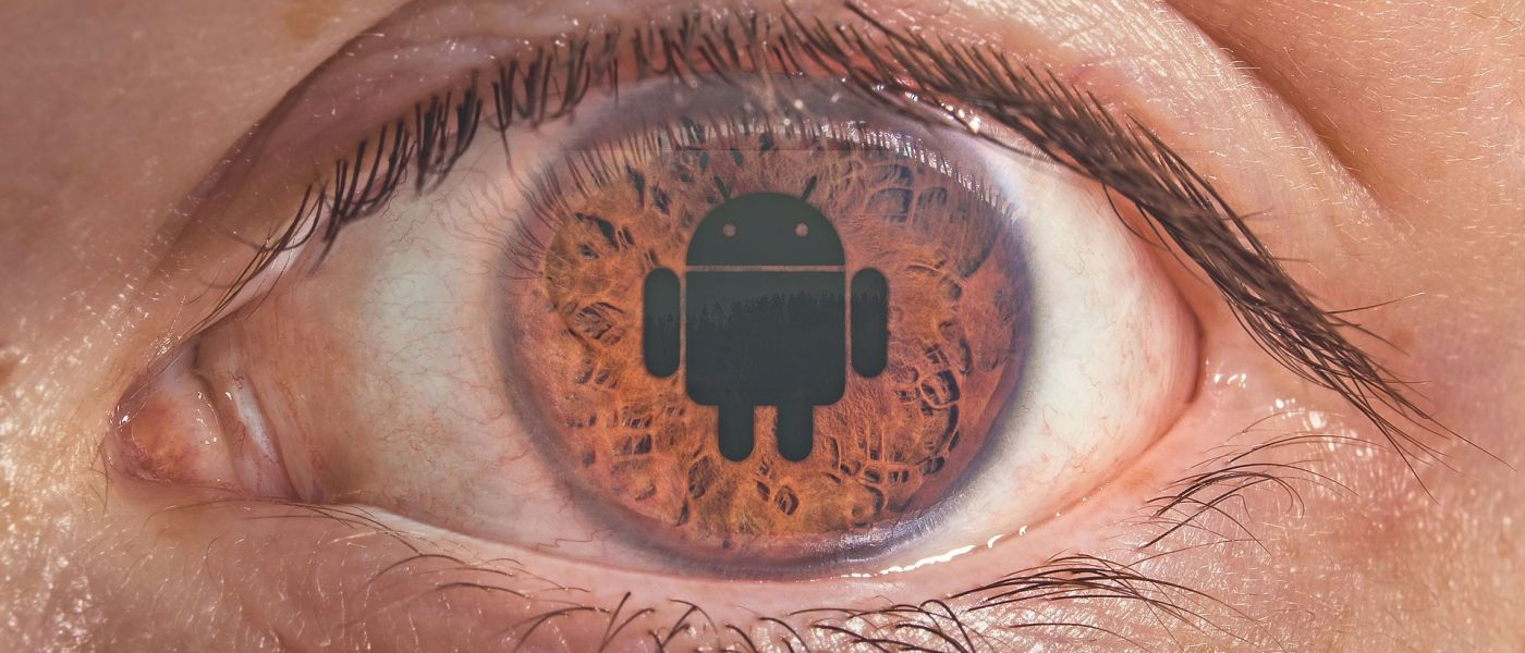 Closeup picture of an eye with the Android logo overlaid on the retina.