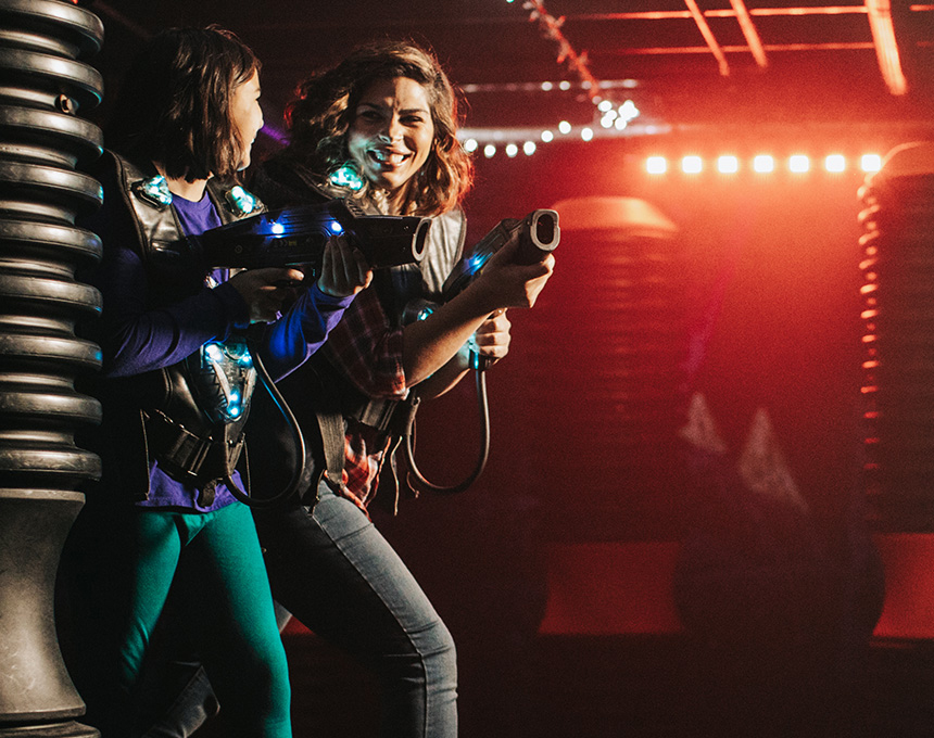Two people playing laser tag