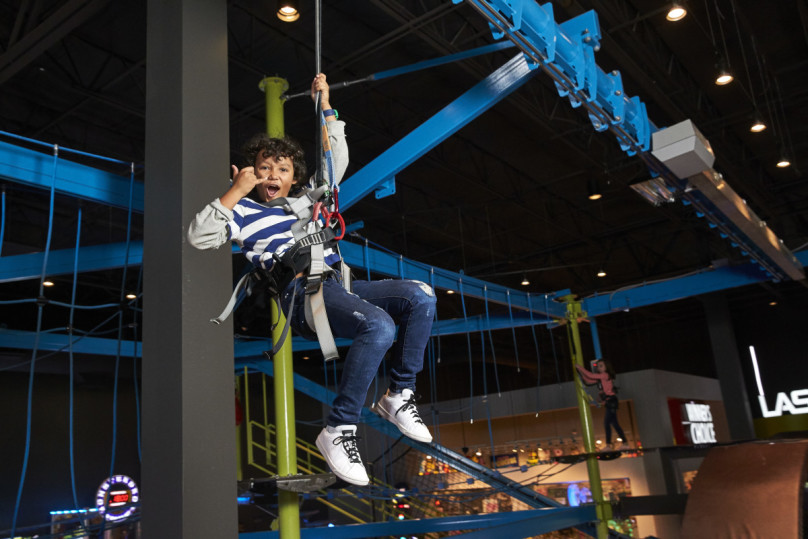 Kid on zip line in Gravity ropes