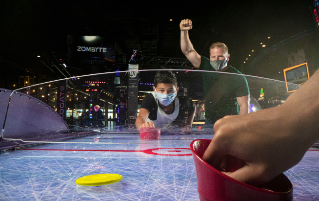 Playing air hockey with masks