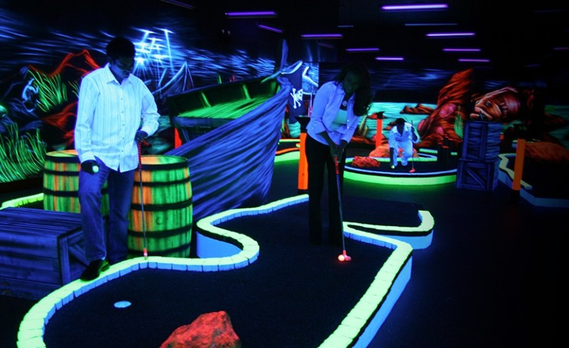 Guests playing glow in the dark golf