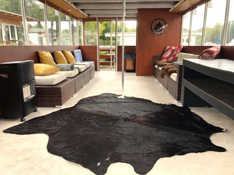 Heated salon of the Beluga raft in winter with cowhide and blankets