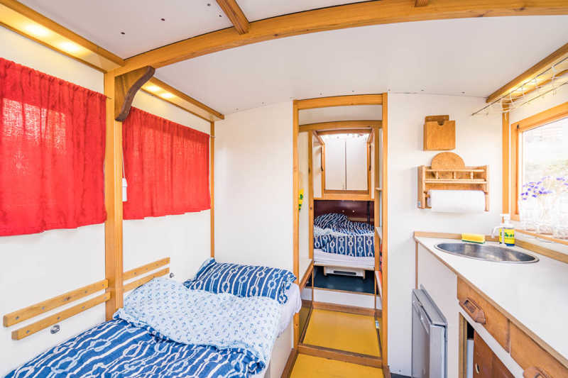 Bedroom and kitchenette on the Berlin houseboat Wasserkutsche