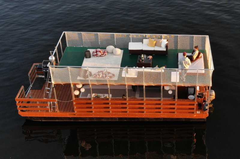 Bird's eye view of Beluga party boat with large sundeck, lounge furniture and cozy area