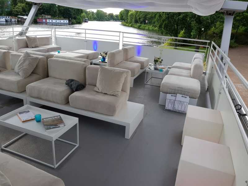 Roof terrace of the seminar ship with lounge furniture
