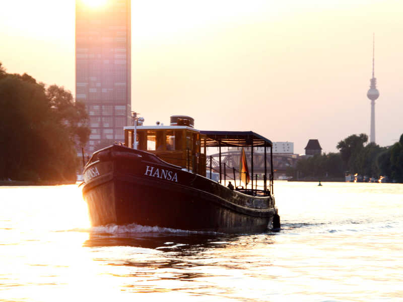 Party boat Hansa on a boat tour across the Spree with the Berlin TV tower in the background
