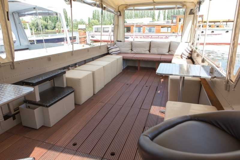 Salon with lounge furniture on the Kotaro party boat