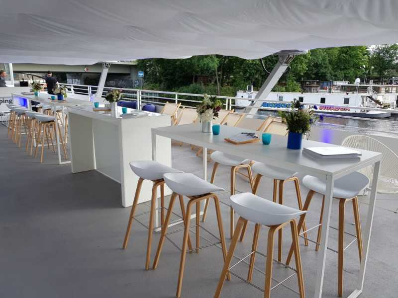 Modern roof lounge with tables and stools on the seminar ship from Berlin boat rental