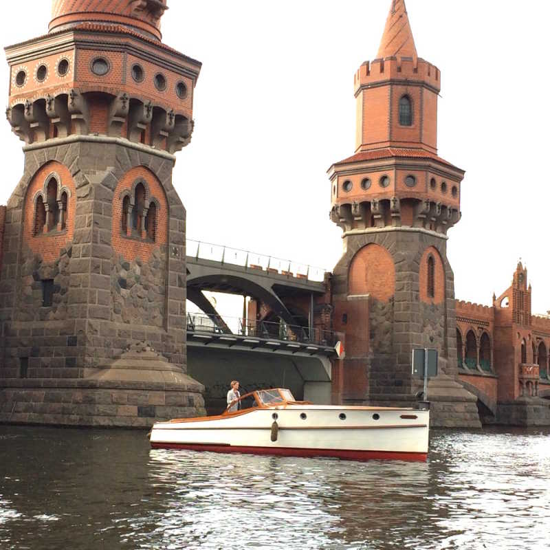 Boat Marlene in front of the Oberbaum Bridge in Berlin