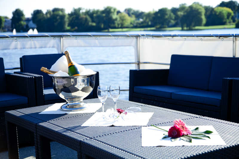 Upper deck with lounge furniture and champagne at the yacht Casino