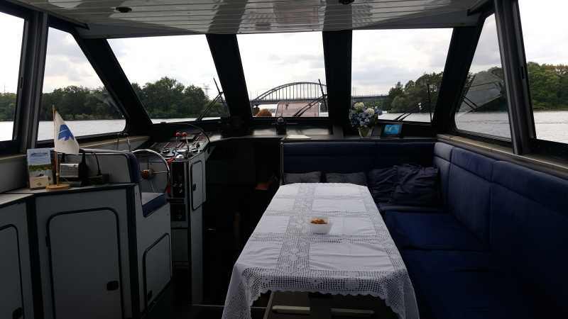 Driver's stand with a comfortable dining table on the Araya yacht
