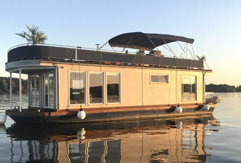 Berlin event ship and houseboat Jaxs in our boat rental at sunset