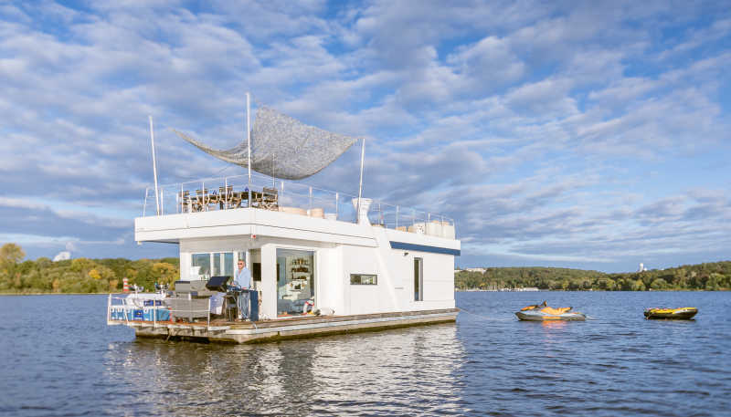 Luxury party boat H2Loft on the Havel with a jet ski in tow