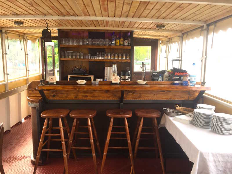 Bar, counter and stool made of wood on the party ship Vera