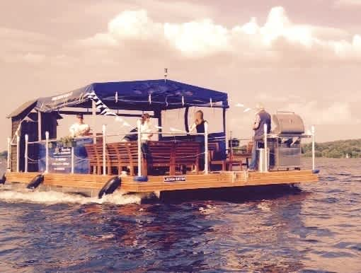 Rent a party raft with grill for 30 people in Berlin