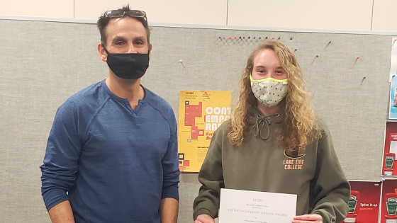 Anthony Ezzo and Marina Puhalj with an embossed Award Certificate for the winning project.