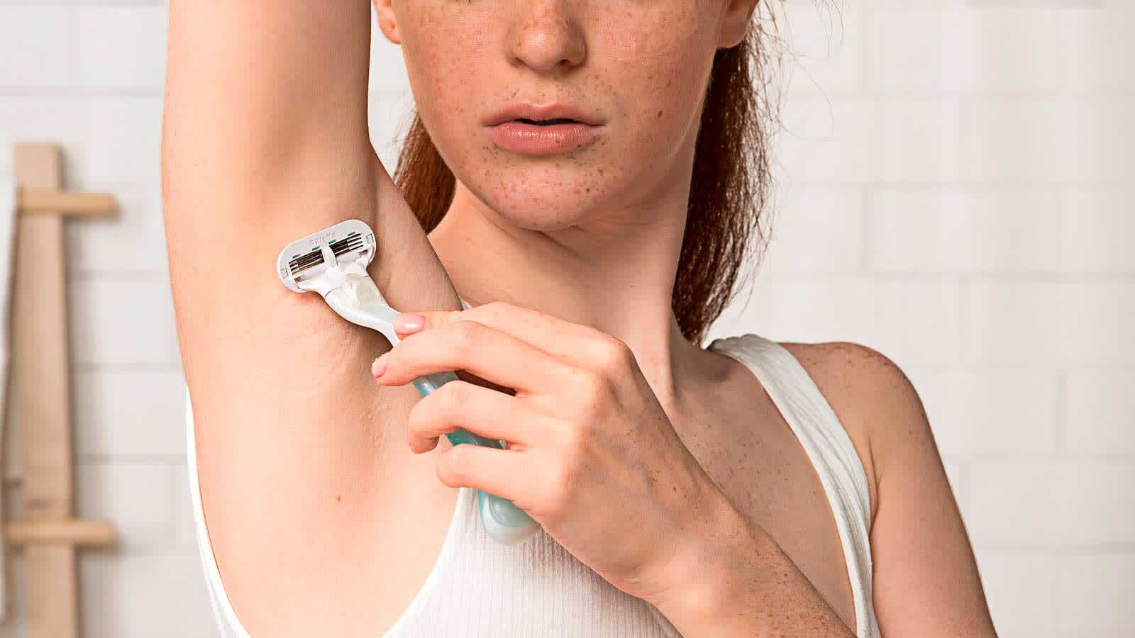 Woman Shaving Her Armpit with Gillette Venus Women's Razor