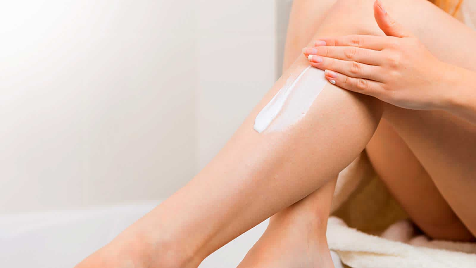 Woman Apply Moisturizer After Shaving Legs