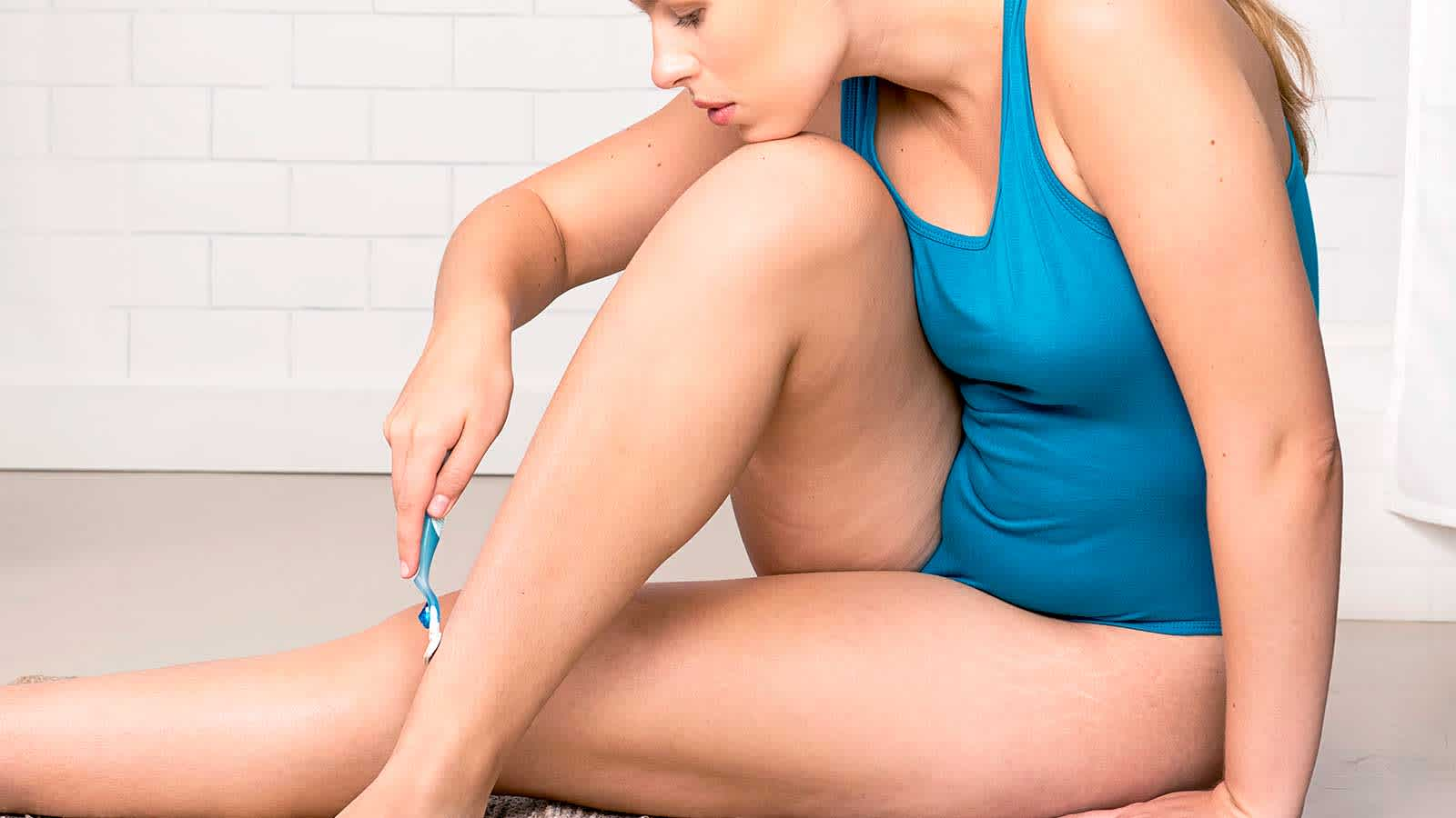Women Carefully Shaving Her Legs with Gilette Venus Razor