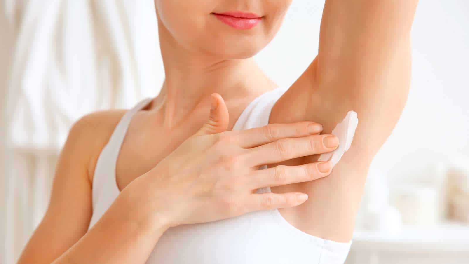 Woman Moisturizing Her Armpit After Shaving