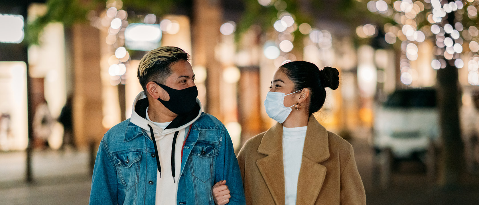 masked man and woman in downtown setting