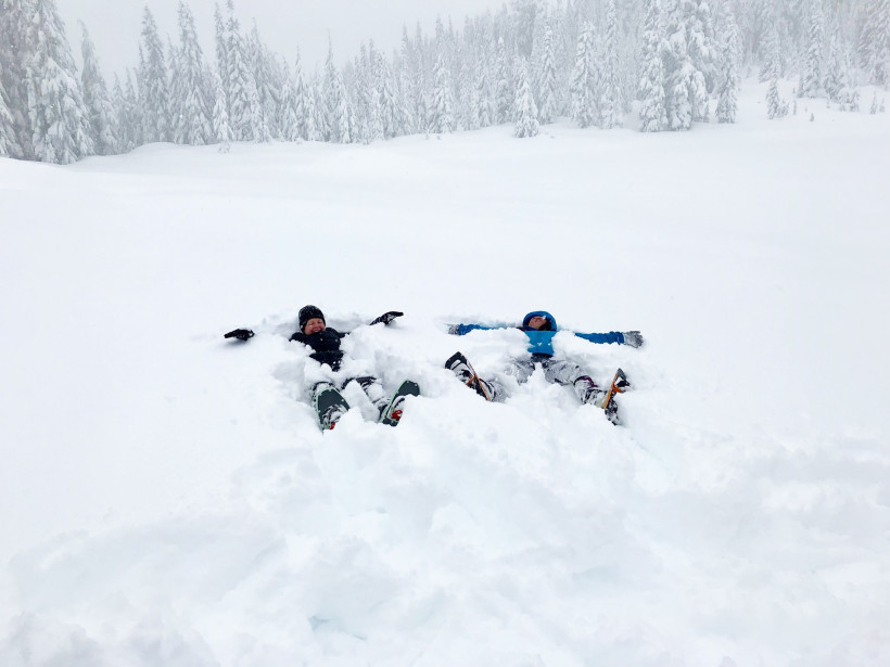 Snowshoers making snow angels on Skyline trail.