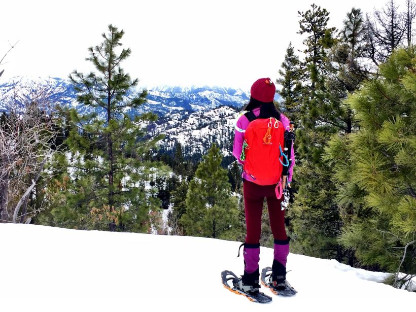 Snowshoer in bright coloured gear, at Wenatchee Crest, taking in the views