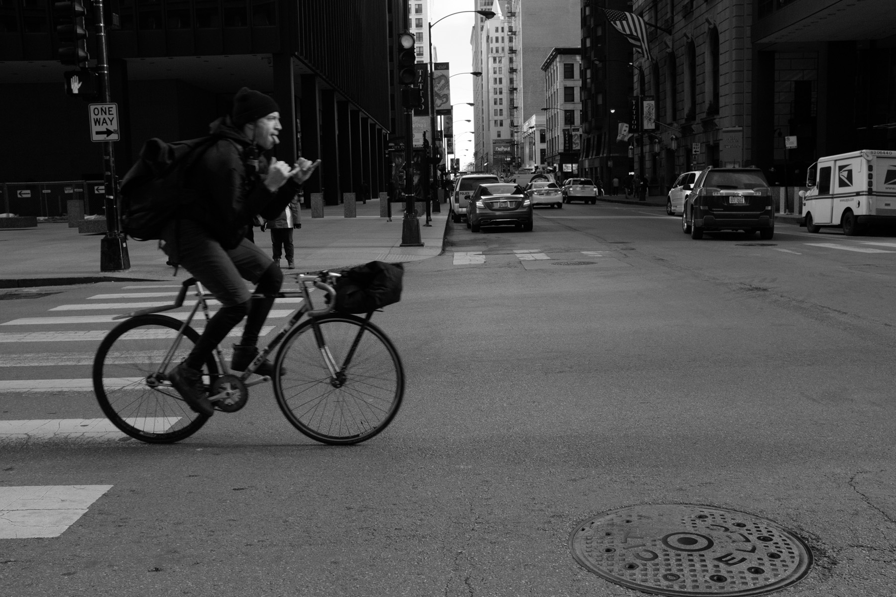from my bike messenger series. He is riding left to right in frame throwing up shaka signs with his hands and sticking his tongue out.
