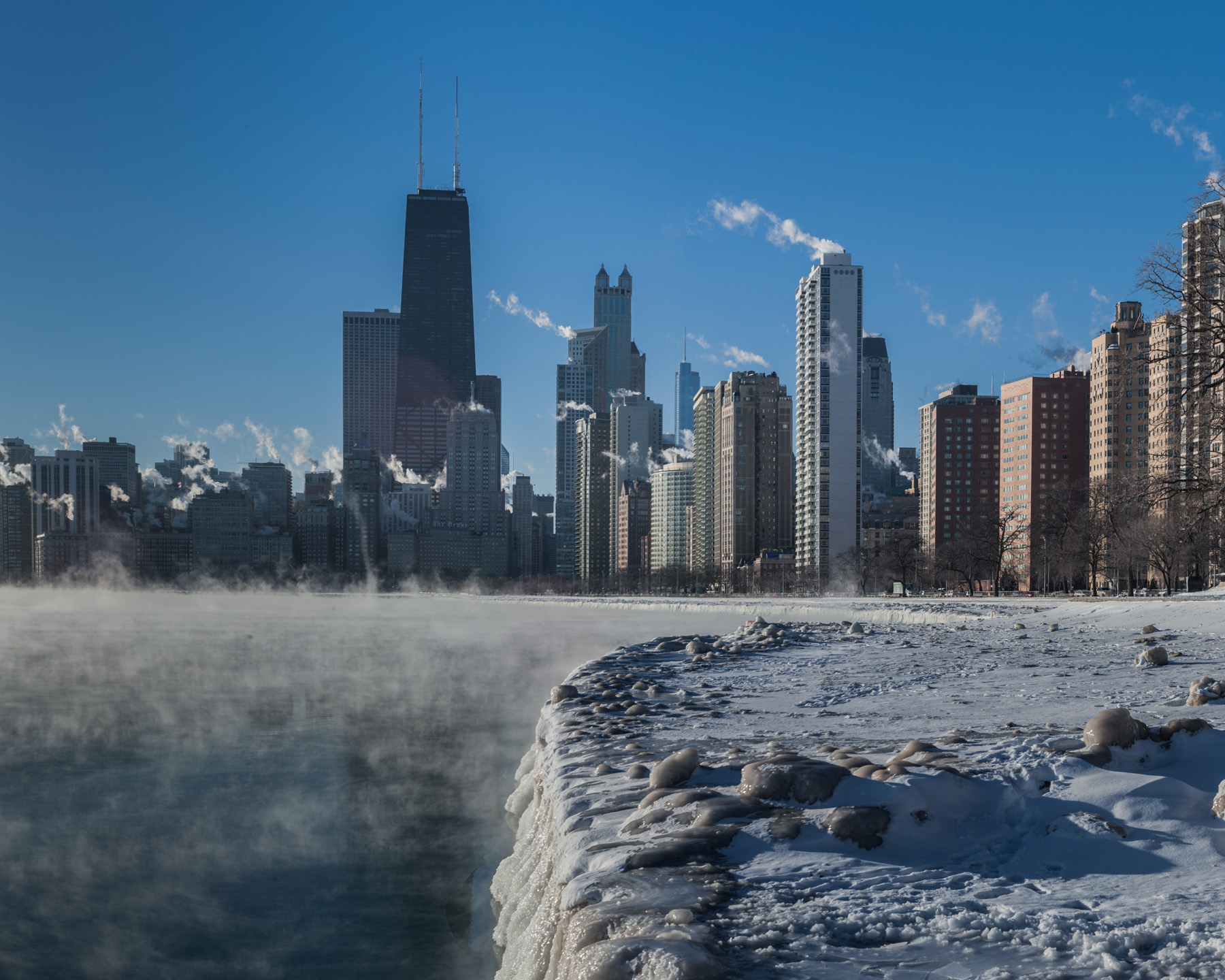 on one of those crazy cold Chicago winter mornings, I took this shot of the skyline with all the steam billowing off the towers and the lake. this shot was taken from the North Ave beach area