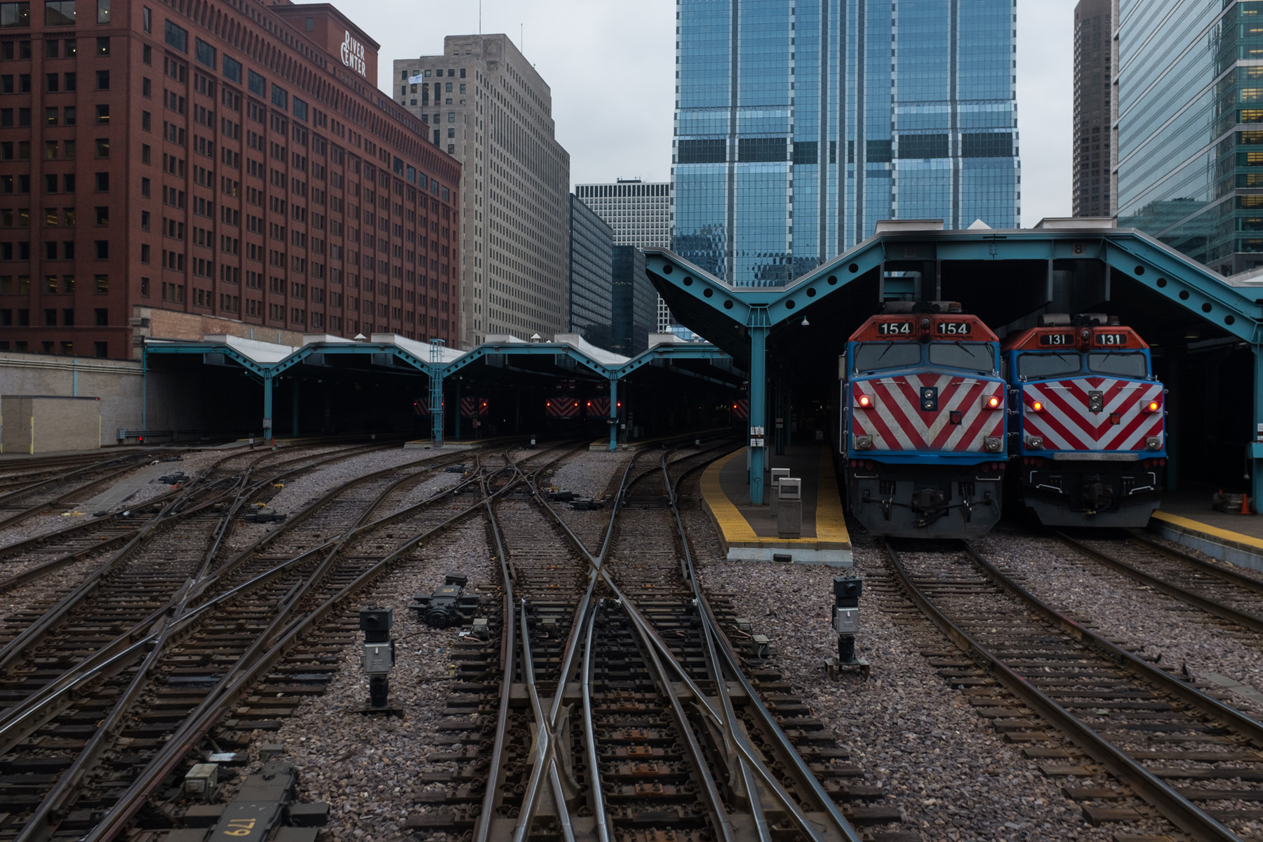 a shot of Ogilvie station with two trains sitting on the platforms, taken from the back of a train as it was leaving the station.