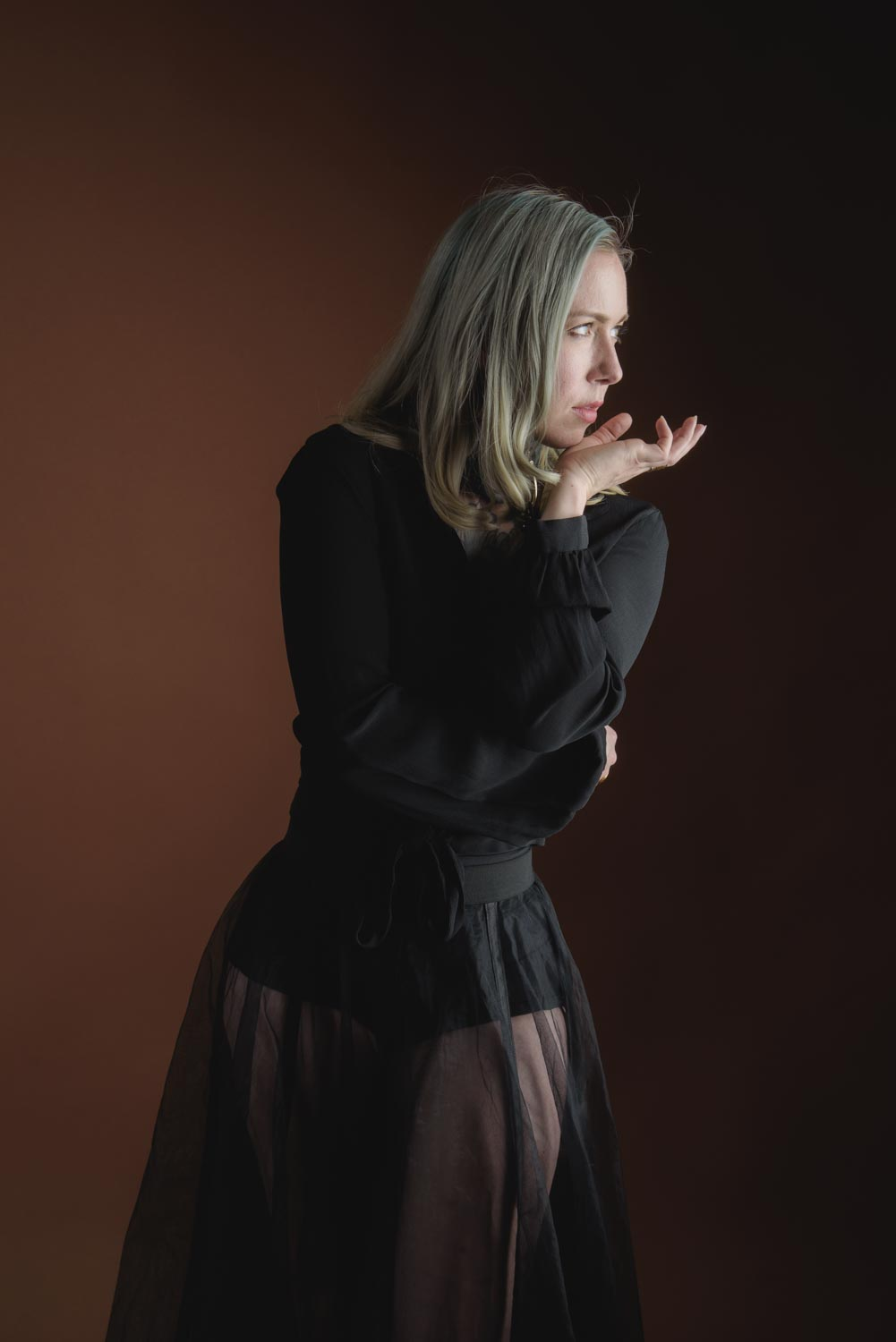 a portrait of Amelie wearing a black blouse and a sheer tulle skirt.