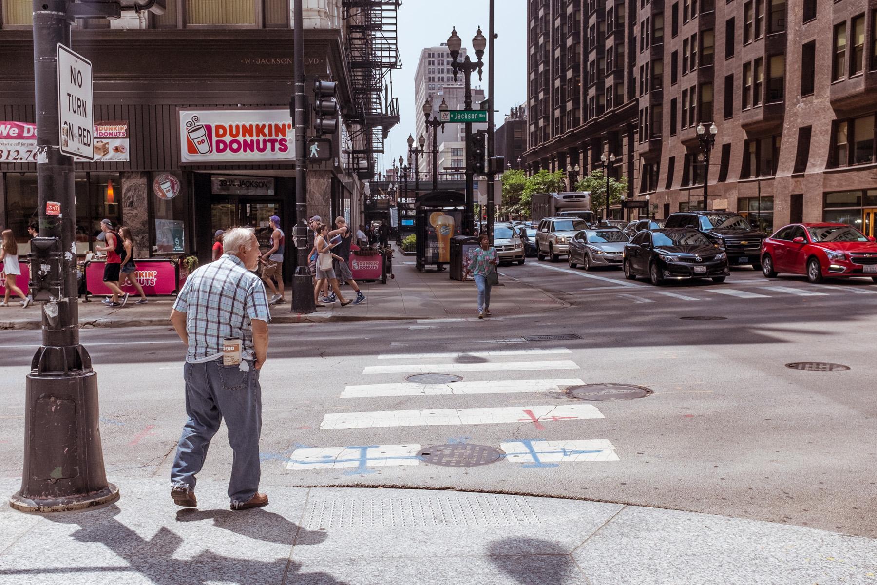 an older gentleman about to cross the street.