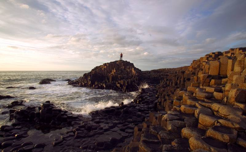 Man standing on top of Giant's Causeway