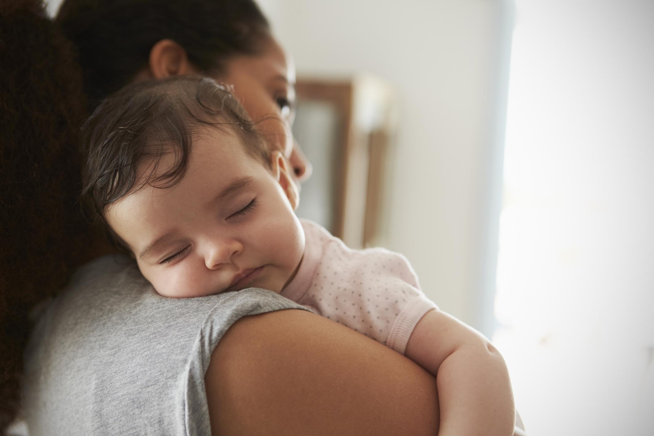 Mother Cuddling Daughter