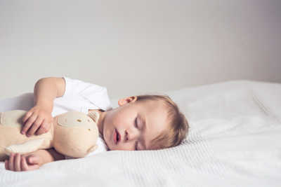 Toddler sleeping with bunny