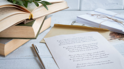 Poetry with old books on white wooden background