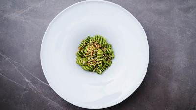 Massimo Bottura's pesto and pasta on white plate