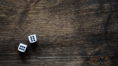 White dice on wood table