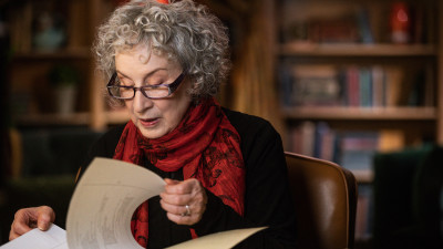 Margaret Atwood looking at papers in library