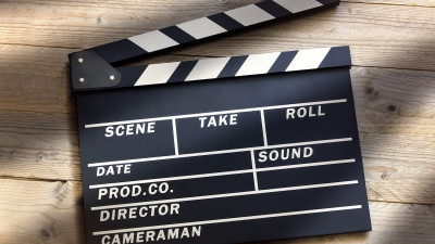 Movie Clapperboard with shadows on wood