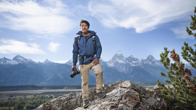 Photographer Jimmy Chin standing on a mountain