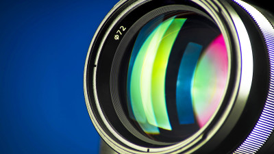 Camera lens up close with color reflection