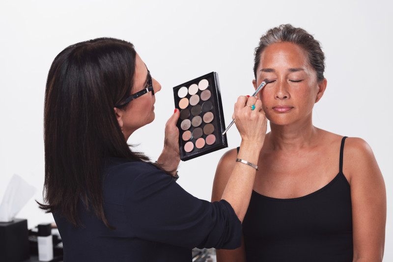 Bobbi Brown applying eyeshadow to model