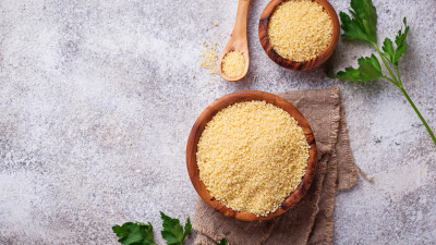 couscous in wooden bowls with herbs