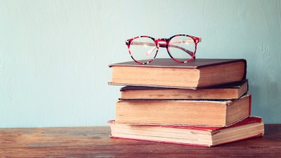Stack of books with glasses on top