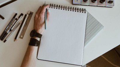 An image of someone starting to make a storyboard from a blank paper